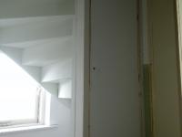 Trap met deurkozijn