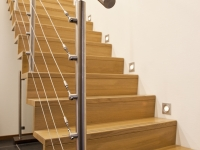 Eiken keepboomtrap met RVS balustrade